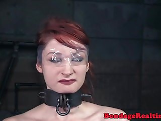 Redhead bdsm sub whipped and clamped