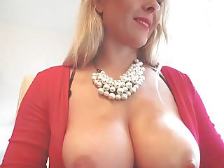 milf with big tits puts finger in ass