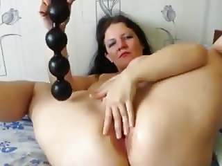 Mature toying her ass