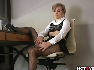 Mature fingers herself in her office