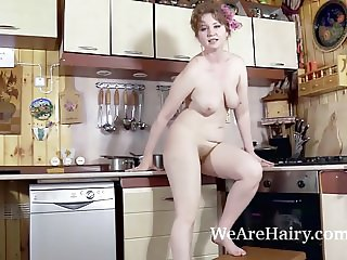 Bazhena masturbates in her kitchen