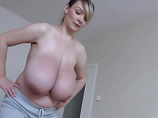 Extremely busty preggo lady doing special exercises.mp4