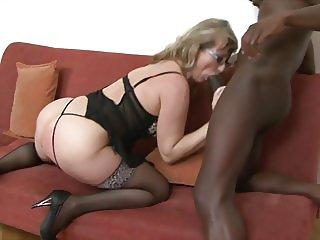 voluptuous granny with glasses riding a big black cock