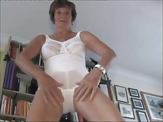 Mature strip - Pantycorselette with big tits