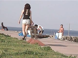 Walk the beach with damaged shot jeans 01
