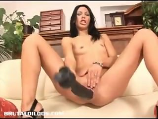 Skinny Russian Marty fills her pussy with a long dildo