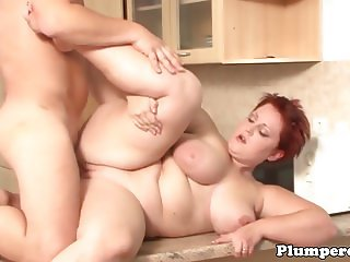 Redhead bbw titfucked and plowed in kitchen