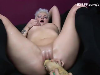 Short haired chubby kitty tries to insert huge toy in petite pussy