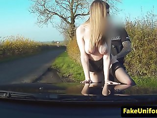 UK slut sucks policemans cock in police car