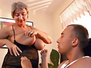Busty Granny Seduces Young Guy With Her Big Tits