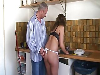 Busty dilligent babe in the kitchen