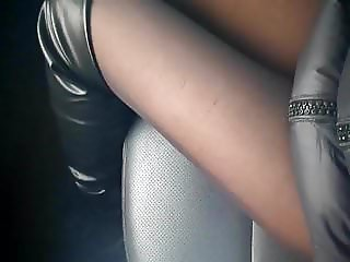 My legs in nylon pantyhose in the car