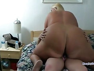 Big fat ass straddles her GFs strapon
