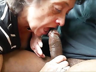Granny gives a head & swallow on black cock.