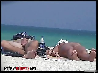 Naked tourists caught on beach spy cam relaxing and enjoying