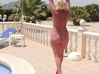 Mature with a naked bare ass walks by the pool