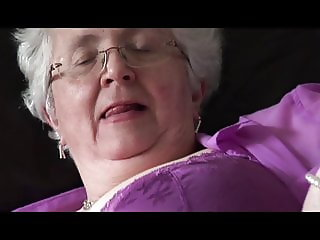 Granny with massive boobs showing hairy pussy upskirt