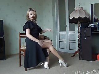 Hot lady in black dress showing legs and pussy