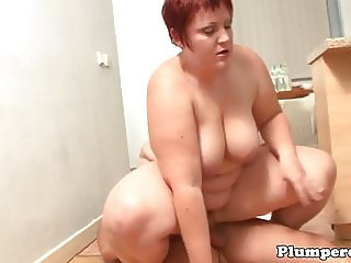 BBW beauty tittyfucked in the kitchen