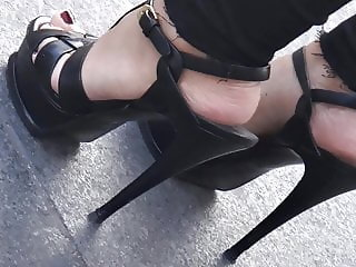Candid hot blond with ysl high heels