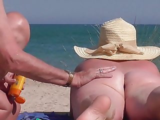 wife gets interest on the beach