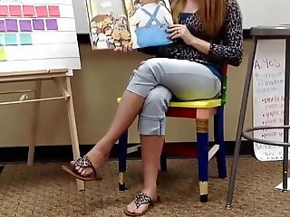 1st grade teacher playing with flip flops during a lesson