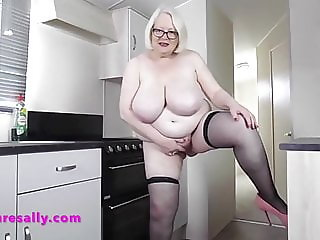 Lovely Sally gets her tits out in the kitchen