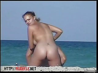 A nude beach voyeur films a funny girl
