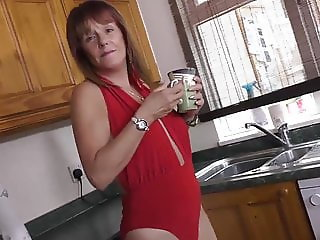 Mom in red masturbating on her kitchen