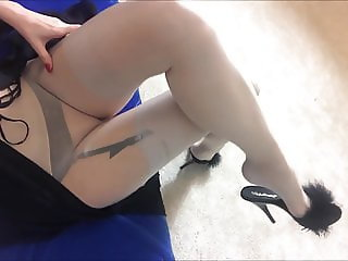 amateur blond in layered pantyhose and nylon stocking