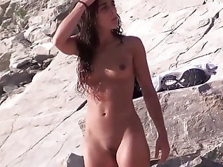 Tight Body Brunette Nude at the Beach