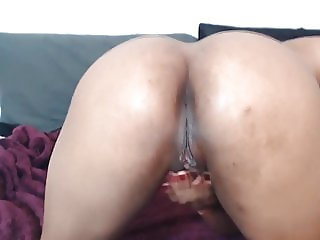 Moaning Afro nympho with big booty and hairy pussy