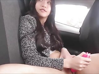 Asian GF masturbates with toy in  backseat of car