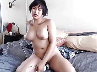 Sweet busty Asian chick fingers pussy and rides vibrator