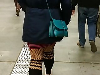 Thick legs in fishnet pantyhose