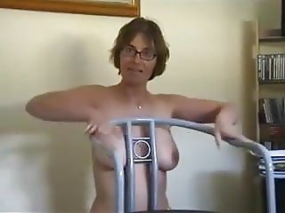 Milf strips and gives blowjob