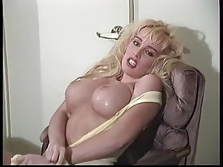 Wet Sandra Scream shows her big tits and ass
