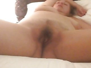 Dreamy MILF in her hotel room at night fingered by a voyeur