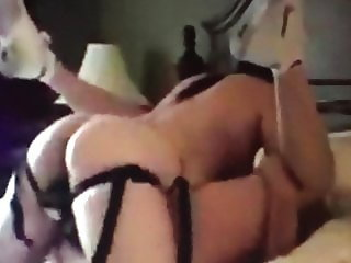 Hooker fucks me with wife's strapon