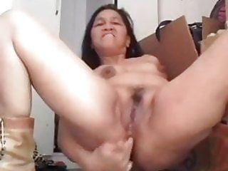 Phillipino milf fingering her arse and cumming.