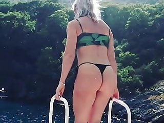 Milf Claire shows her ass in a tiny thong bikini