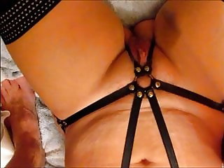 Using a riding crop on her pussy