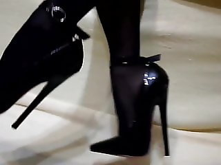 Extremely high heels with red soles