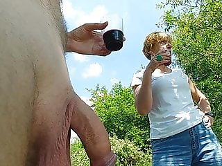 Mature woman talking to a naked man.