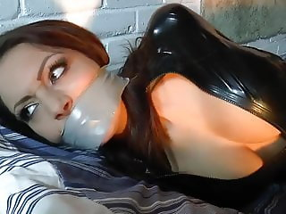 Girl in Latex Catsuit Hogtied and Tape gagged