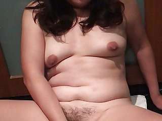 Asian wife playing with banana