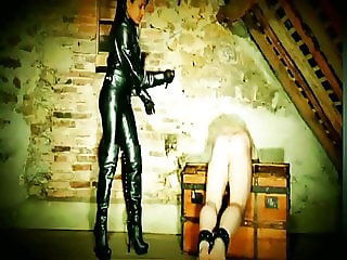 Strict Leather Mistress Caning Slave