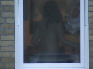 Woman spied nude through kitchen window
