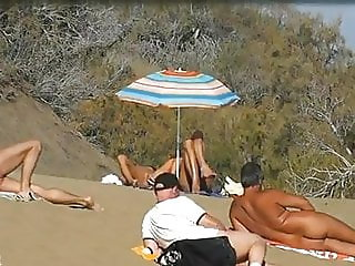 Slutwife masturbating for pervs in a beach
