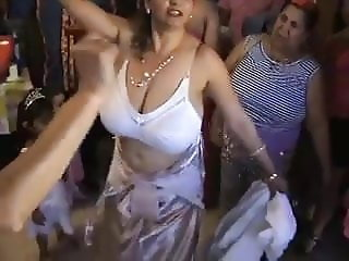 A woman with a huge bust dancing